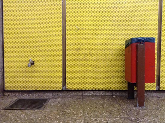 street drain, garbage can, street scene